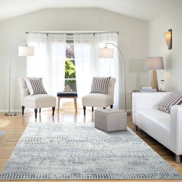 room with gray and ivory rug