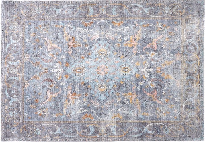 antique style rug in subtle blues