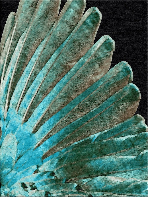 Rug with black background with teal feather design