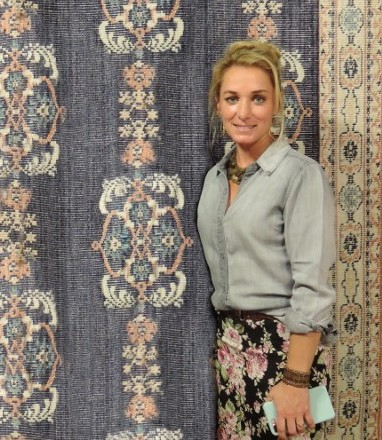 portrait in front of classic rugs