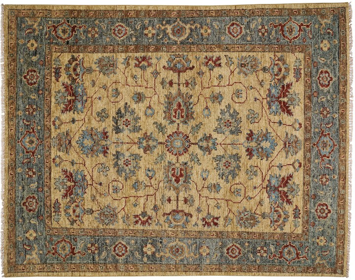 A gold rug with a blue border and a red intricate flower design