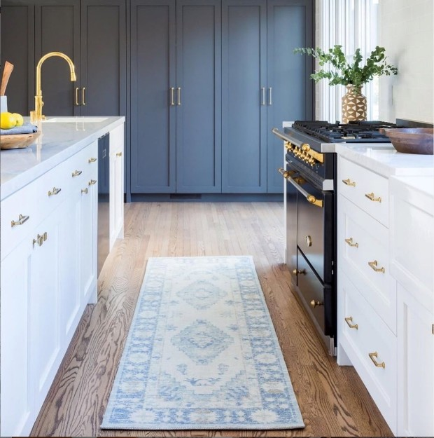image of a blue and ivory rug in contemporary kitchen