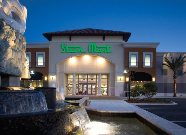 Stein Mart store front with a fountain in front of it